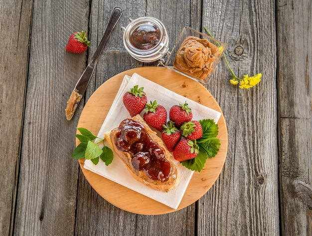 Sandwiches with peanut butter, jam and fresh fruits