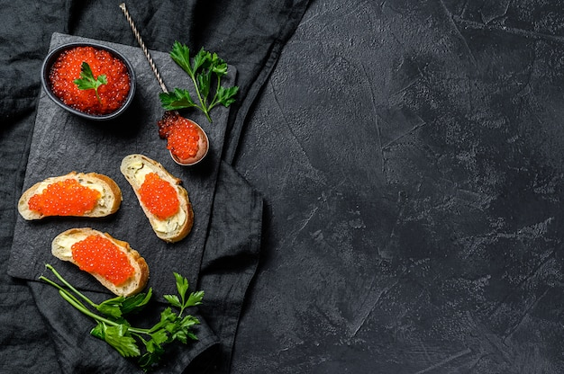 Sandwiches with salmon red caviar. top view.