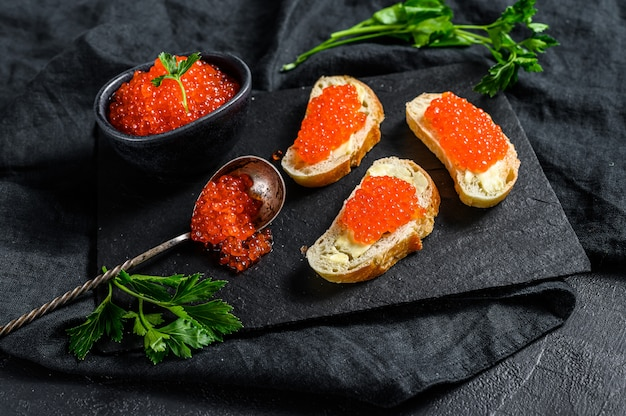 Sandwiches with salmon red caviar. top view