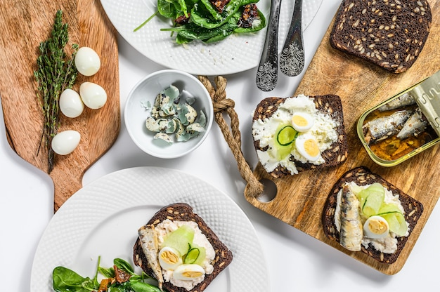 Sandwiches with sardines, egg, cucumber and cream cheese