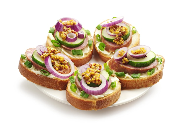 Sandwiches with sausage and greens