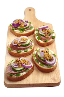 Sandwiches with sausage and onion
