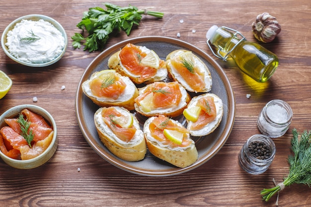 Sandwiches with smoked salmon and cream cheese and dill.