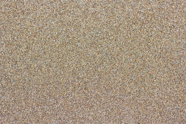 砂浜の背景。詳細な砂のテクスチャ、トップビュー