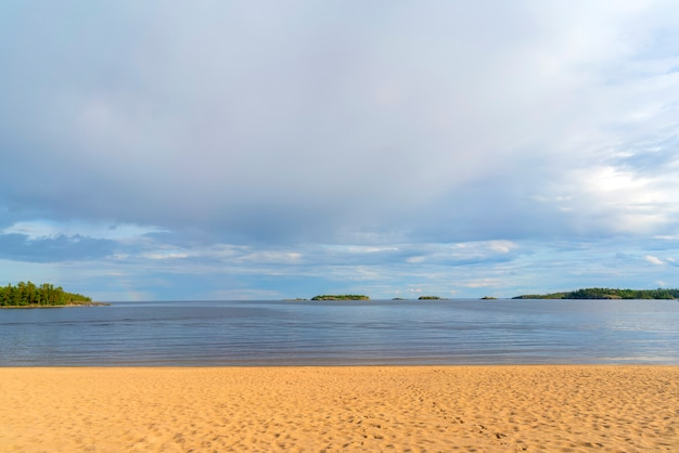 Sandy beach on the shore of a clean lake.