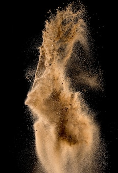 Sandy explosion isolated on over dark background,abstract sand cloud,motion blur