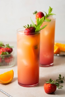 Sangria with strawberry, mint and orange in glasses. summer refreshing fruit cocktails