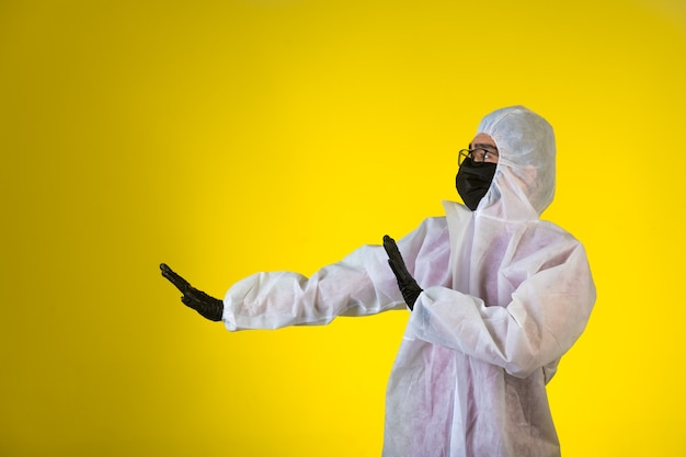 Sanitizer in special preventive uniform and masks stops the danger coming from left side