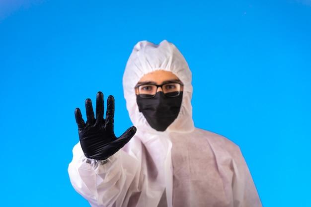 Sanitizer in special preventive uniform stops danger in the center.
