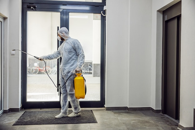 Sanitizing interior surfaces. cleaning and disinfection inside buildings, the covid-19 epidemic. sessional teams for disinfection efforts. infection prevention and control of epidemic.