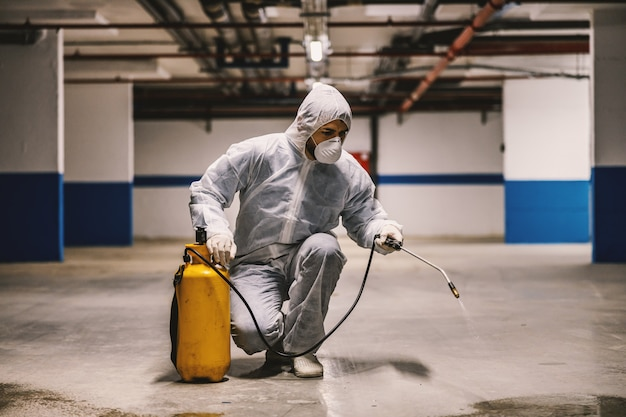 Sanitizing interior surfaces, garage. cleaning and disinfection inside buildings, the coronavirus epidemic. professional teams for disinfection efforts. infection prevention and control of epidemic. p
