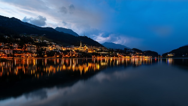 Sankt  moritz at dusk on the lake after a thunderstorm