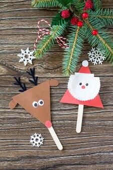 サンタとトナカイのスティック人形子供のための子供たちの創造性工芸品の手作りプロジェクト