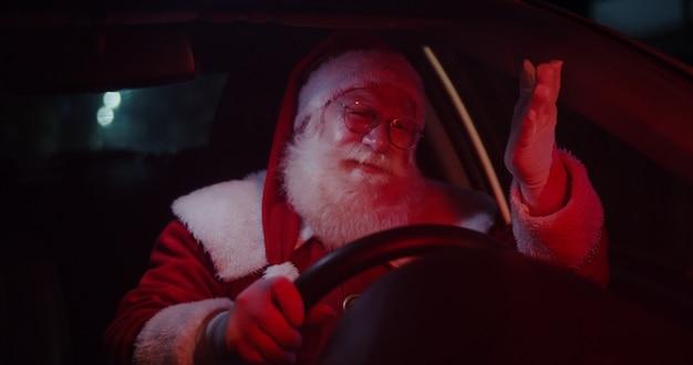 Santa claus annoyed in car stuck in traffic.