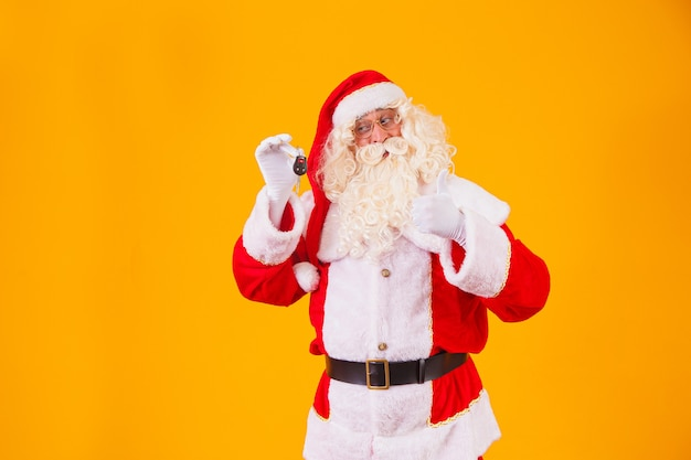 Santa claus carries car keys in a special year-end promotion