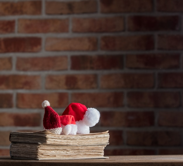 Santa claus christmas hats and old books