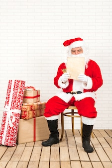 Santa claus concentrated on reading christmas letter