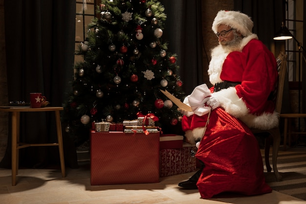 Santa claus delivering christmas gifts