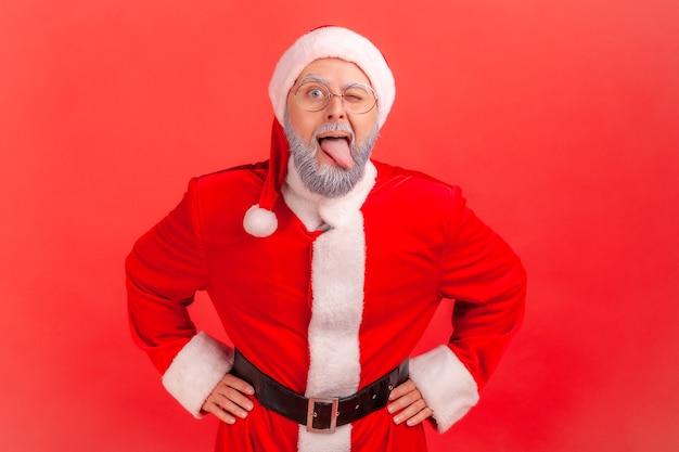 Santa claus demonstrating tongue, behaving naughty unruly, childish mood.