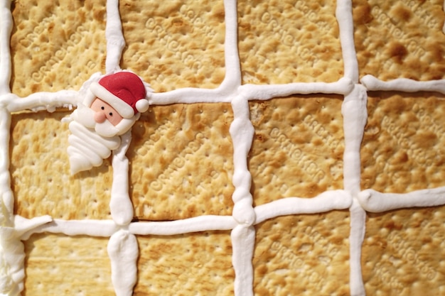 Santa claus doll on biscuit with bread background.
