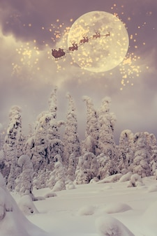 Санта-клаус летит по небу над заснеженным лесом