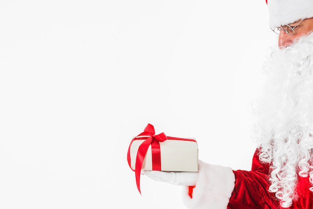 Santa claus in glasses holding gift box