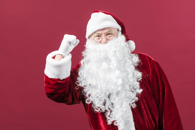 Santa claus in glasses showing fist