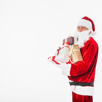 Santa claus in glasses with gift boxes