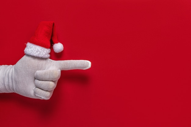 Santa claus gloved hand is pointing gesture