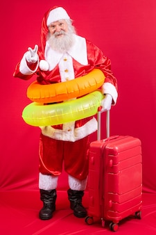 Santa claus going on vacation in the summer