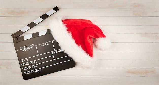 Santa claus hat and movie clapper