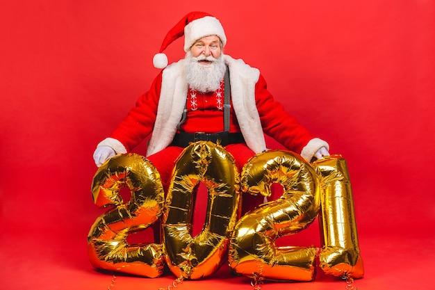 Santa claus holding balloons 2021