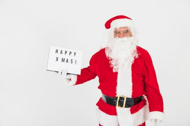 Santa claus holding greeting board
