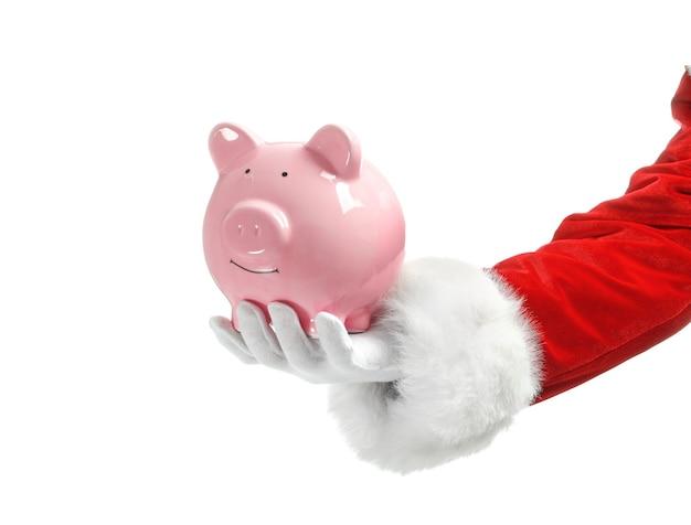 흰색 바탕에 돼지 저금통을 들고 산타 클로스