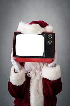 화면 빈 크리스마스 크리스마스 휴가 개념 복고풍 tv를 들고 산타 클로스