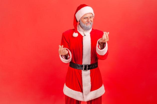 サンタクロースがお金を稼ぐジェスチャー、支払い、手当を求める、カメラを見る。