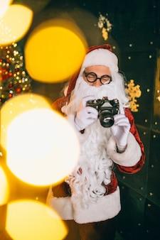 Santa claus making photos on camera