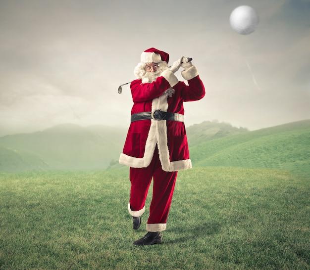 Santa claus playing golf