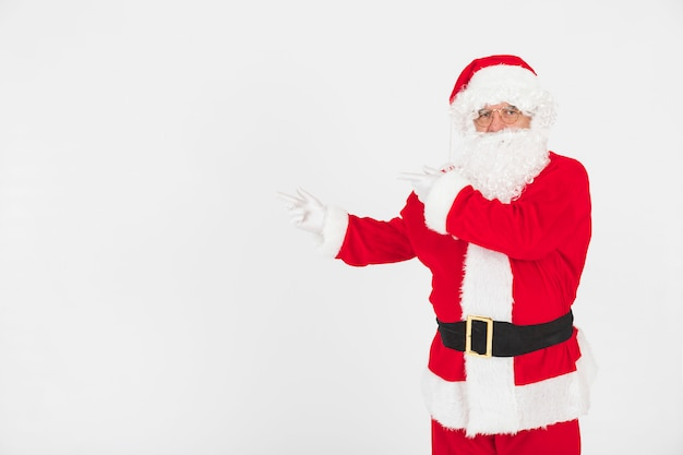 Santa claus pointing at emptiness