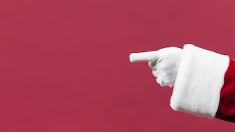 Santa Claus pointing left with hand