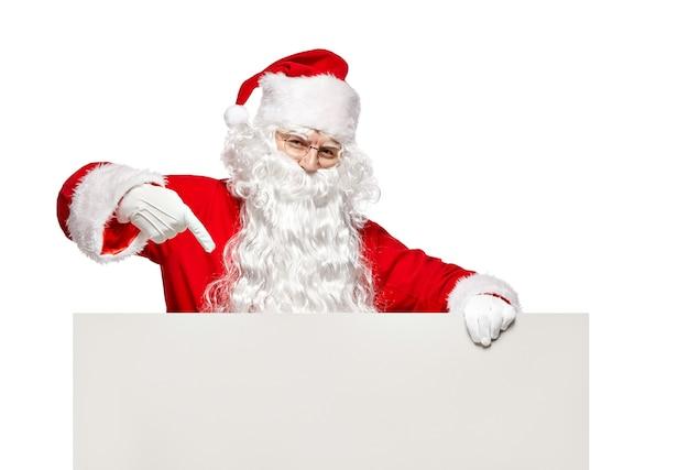 Санта-клаус, указывая на пустой знамя