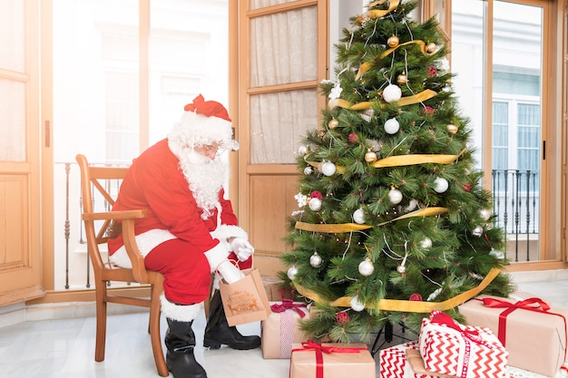 Santa claus preparing presents for new year