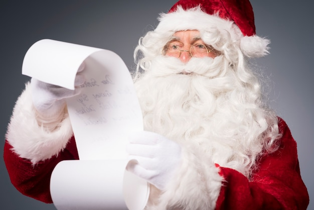 Santa claus reading a wishes list
