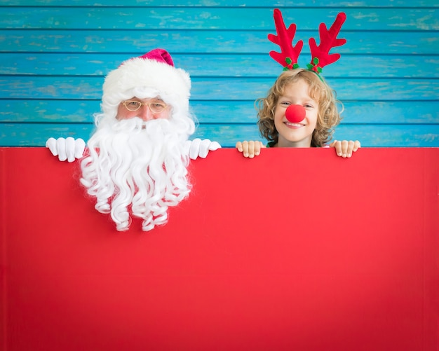Santa claus and reindeer child holding banner blank merry christmas greeting card xmas holiday