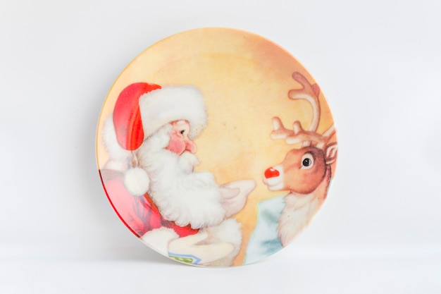 Santa claus and reindeer painted plate on white background