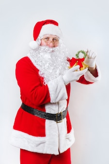 Santa claus ringing a bell on a white   , christmas time,