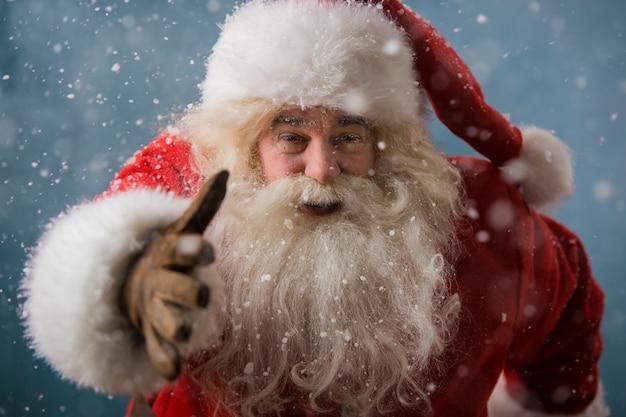 Santa claus running outdoors at north pole