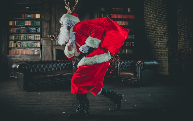 Santa claus running with bag of gifts