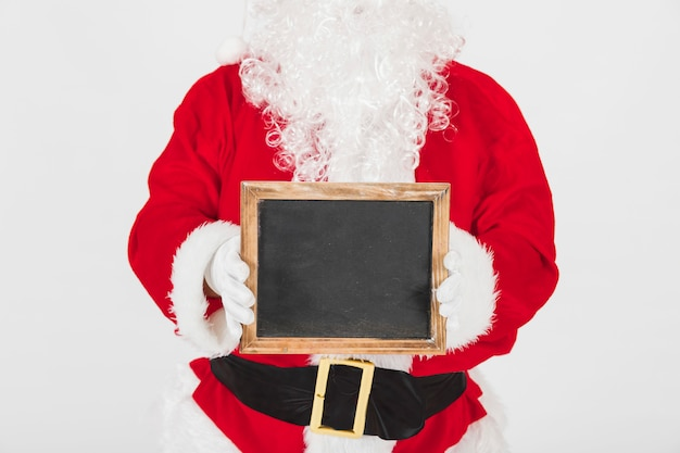 Santa claus showing empty wooden frame