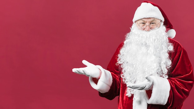 Santa claus showing something with hands